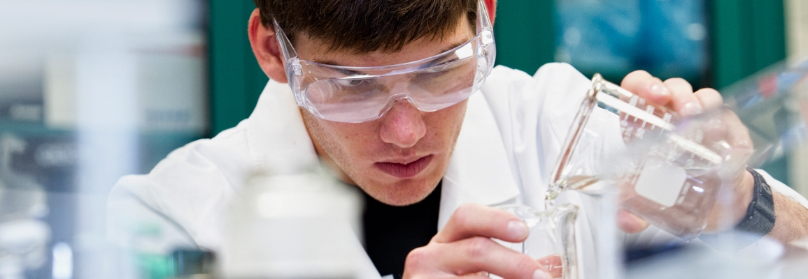 chemistry lab student pouring liquids